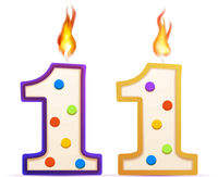 Eleven years anniversary, 11 number shaped birthday candle with fire on white