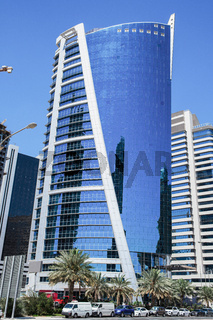 Daytime view of a tall building in Doha city center.