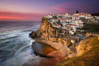 Azenhas do Mar traditional picturesque village in Portugal at sunset