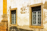 Historic church windows in colonial style with rustic stone frame
