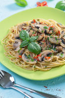 Pasta with mushrooms, onions and parsley.