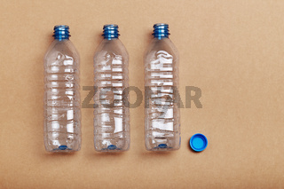 Empty plastic bottles put in a row
