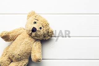 teddy bear on white table