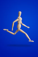 Sports wooden toy figure on blue