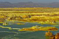 Volcanic landscape with sulphure rock formations and an acid brine pool, Dallol, Ethiopia