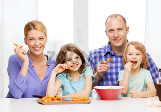 happy family with two kids eating at home