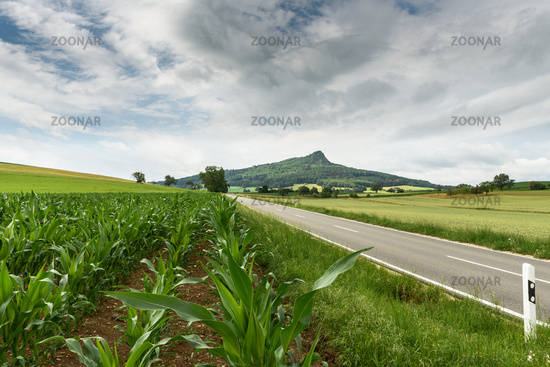 Road in the volcanic landscape Hegau, on the right the Hegau volcano Hohenstoffeln, Germany