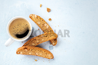 Biscotti. Traditional Italian almond cookies with a cup of coffee, shot from the top