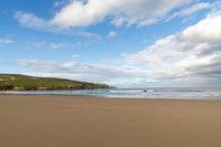 A beautiful wide empty golden sandy beach in Spain