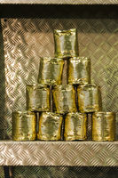 Old tin cans stacked in a pyramid