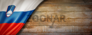 Slovenian flag on vintage wood wall banner