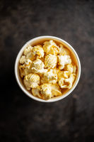 Sweet tasty popcorn in cup.