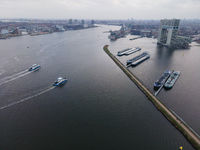 Amsterdam Houthaven, North-Holland, The Netherlands - 12-19-2020 Ferries from the public transport compant GVB on the water the river Ij in Amsterdam city center.