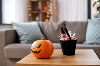 jack-o-lantern and candies at home on halloween