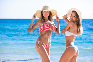 Female friends on beach at vacation