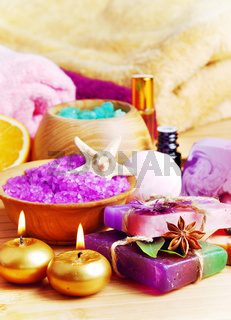 Spa setting with natural soap and sea salt