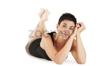 happy woman lying on her stomach