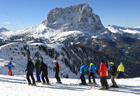 Skiers at the Gardena Pass against the Saslonch mountain, Sassolungo, Dolimites, Italy