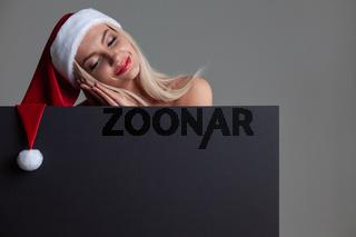 Santa girl holding blank billboard