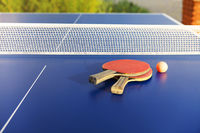Ping pong equipment on blue table