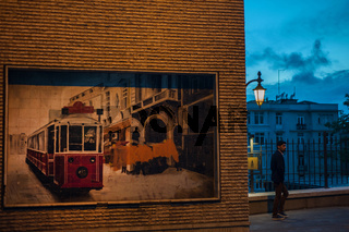 Poster for the tram on Istiklal Street at evening time in Istanbul, Turkey