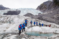 Tourists hiking on Franz Josef Glacier, New Zealand