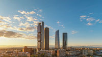 Madrid Spain, sunset city skyline at financial district center with four towers