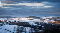 landscape with solitude farm in the hills of lower austria in winter