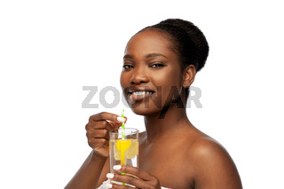african american woman with glass of fruit water