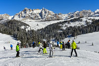 Skiers on a ski slope in the ski resort Alta Badia, Dolomites, South Tyrol, Italy