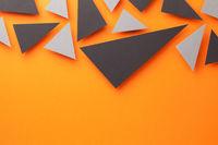 Black And Gray Triangular Shapes On Orange