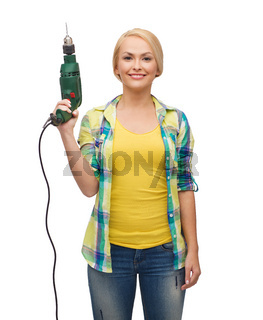 smiling woman with drill machine
