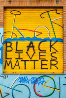 Black Lives Matter sign painted in the shutter of a store