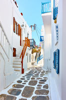 Street with whitewashed houses in Mykonos