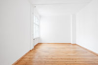 empty white room in apartment flat  with wooden floor