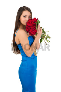 Brunette woman with a big bouquet of red roses