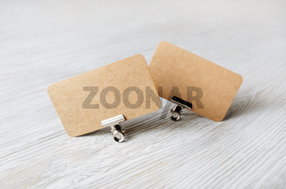 Two kraft business cards