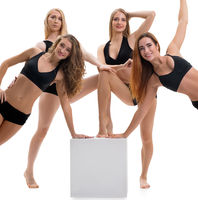 Female sporty dance group posing be cube in studio