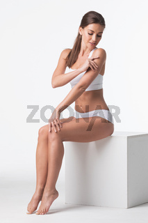 Woman in underwear touching own skin