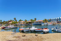 Little harbor with motor boats and houses