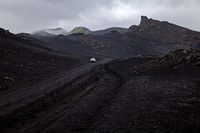 black lava landscape with a car, Landmannaleid, Krókagiljabrún, near Hekla, Iceland, Europe