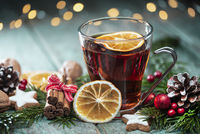 Mulled wine with spices and defocused lights