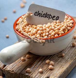 Organic chickpeas in a ceramic bowl.