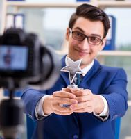 Businessman recording a video for vlog