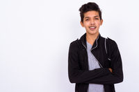 Portrait of young handsome Indian teenage boy