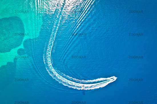 Speed boat and water parachute or parasailing aerial view