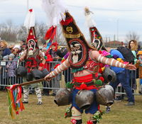 People with mask called Kukeri dance and perform to scare the evil spirits.