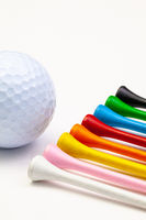 Golf set - golf ball and wooden tees.