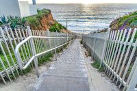 Mountain stairs overlooking ocean and sunset in San Diego California beach