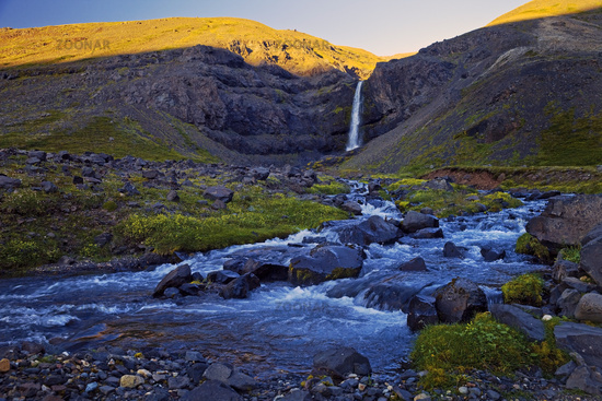 River Gilsá with waterfall in the valley of the mountain Hoettur and Sandfell, Iceland, Europe